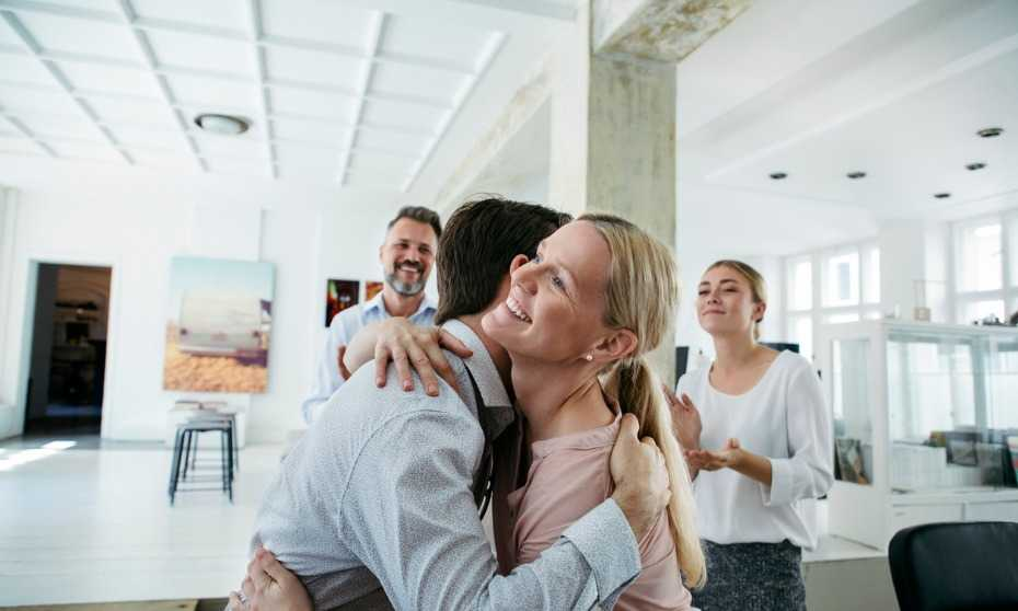 Should your workplace ban hugs?