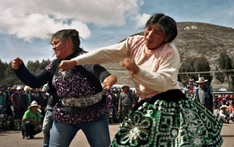 Lighter Side: Peru fighting festival lets workers beat up their boss